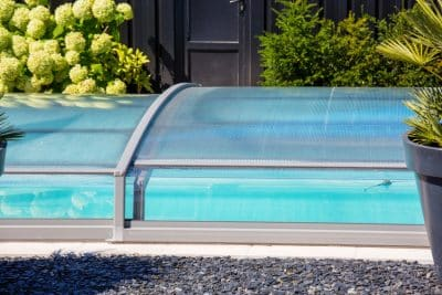 automatic retractable pool enclosure system to protect pool